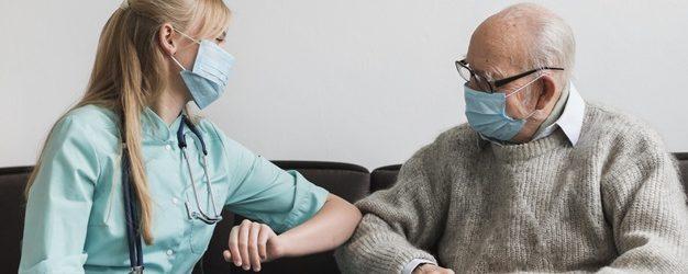 female-nurse-elbow-touching-old-man-during-pandemic_23-2148739982